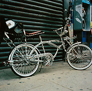 A schwinn bike leaning against some shuttered doors, USA