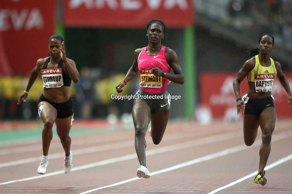 Chandra Sturrup, Kerron Stewart, Kelly Ann Baptiste in action during the 100 metre event, at the IAAF Golden League Track and Field meeting on 17 July 2009 in Paris, France. Photo: Panoramic/PHOTOSPORT *** Local Caption ***