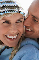 Couple embracing on mountain peak close-up portrait