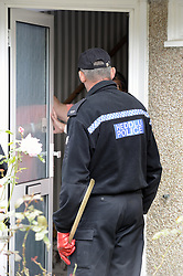 © Licensed to London News Pictures. 07/08/2012 . A Police officer searching door to door in New Addington in the hunt for missing Tia Sharp. 12 year old Tia Sharp has been missing from the Lindens on The Fieldway Estate in New Addington since Friday last week. .Photo credit : Grant Falvey/LNP
