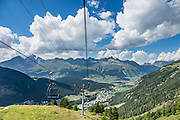 "Hear an alpenhorn concert at Alp Languard, reached via chairlift above Pontresina in Upper Engadine, in Graubünden (Grisons) canton, Switzerland, the Alps, Europe. The Swiss valley of Engadine translates as the ""garden of the En (or Inn) River"" (Engadin in German, Engiadina in Romansh, Engadina in Italian)."