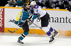 December 9, 2009; San Jose, CA, USA; San Jose Sharks defenseman Alexei Semenov (21) and Los Angeles Kings defenseman Matt Greene (2) collide during the first period at HP Pavilion. Los Angeles defeated San Jose 5-4 in overtime. Mandatory Credit: Jason O. Watson / US PRESSWIRE