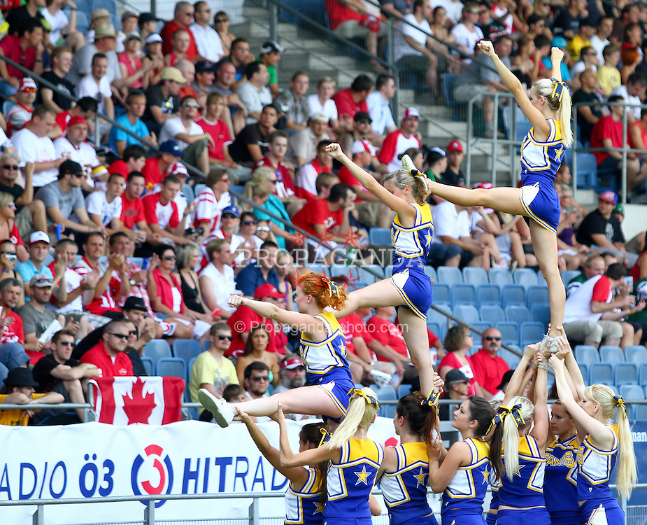 13.07.2011, UPC Arena, Graz, AUT, American Football WM 2011, Group B, Japan (JAP) vs Canada (CAN), im Bild stunt from the cheerleaders // during the American Football World Championship 2011 Group B game, Japan vs Canada, at UPC Arena, Graz, 2011-07-13, EXPA Pictures © 2011, PhotoCredit: EXPA/ T. Haumer