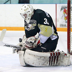 NEWMARKET, ON - Feb 20 : Ontario Junior Hockey League Game Action between the Trenton Golden Hawks and the Newmarket Hurricanes, Denny Dubblestyne #33 of the Trenton Golden Hawks Hockey Club makes the save during first period game action.<br /> (Photo by Brian Watts / OJHL Images)