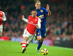 LONDON, ENGLAND - Saturday, November 22, 2014: Arsenal's Alex Oxlade-Chamberlain in action against Manchester United's James Wilson during the Premier League match at the Emirates Stadium. (Pic by David Rawcliffe/Propaganda)