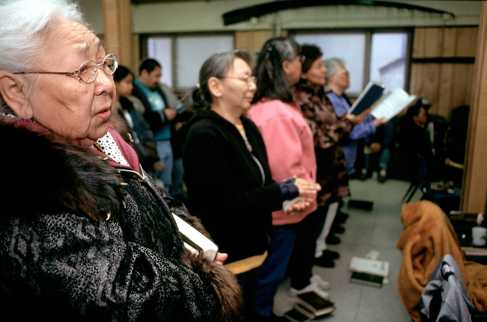 After the service in I&ntilde;upiaq, a singspiration goes on every Sunday night at the Presbiterian Church. <br /> <br /> Martha Aiken on the very left.<br /> <br /> Up on the wall there is a piece of baleen, a common decoraction artifact in Barrow.<br /> <br /> May 18, 22:05