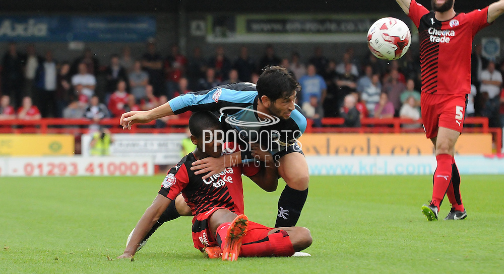 Lewis Young and Joe Jacobson battle for the ball during the Sky Bet League 2 match between Crawley Town and Wycombe Wanderers at the Checkatrade.com Stadium, Crawley, England on 29 August 2015. Photo by Michael Hulf.