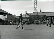 League of Ireland vs Liverpool FC.    (M87)..1979..18.08.1979..08.18.1979..18th August !979..In a pre season friendly the League of Ireland took on Liverpool FC at Dalymount Park Phibsborough,Dublin. The league team was made up of a selection of players from several League of Ireland clubs and was captained by the legendary John Giles. Liverpool won the game by 2 goals to nil..The scorers were Hansen and McDermott..Jimmy Case is pictured fouling an Irish defender in the build up to a Liverpool attack.