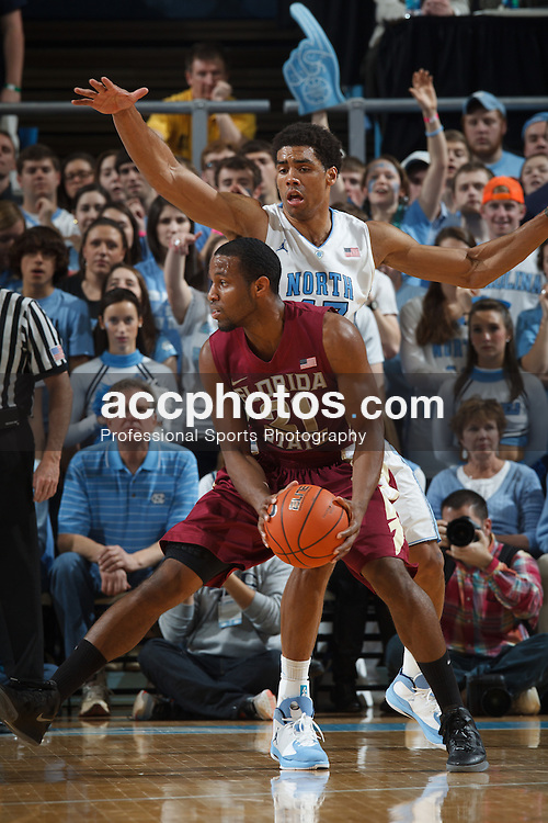 CHAPEL HILL, NC - MARCH 03: Michael Snaer #21 of the Florida State Seminoles passes the ball under pressure from Michael Snaer #21 of the Florida State Seminoles on March 03, 2013 at the Dean E. Smith Center in Chapel Hill, North Carolina. North Carolina won 58-79. (Photo by Peyton Williams/UNC/Getty Images) *** Local Caption *** Michael Snaer;James Michael McAdoo