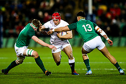 Theo Dan of England U20 is tackled by Sean O'Brien and Dan Kelly of Ireland U20 - Rogan/JMP - 21/02/2020 - Franklin's Gardens - Northampton, England - England U20 v Ireland U20 - Under 20 Six Nations.