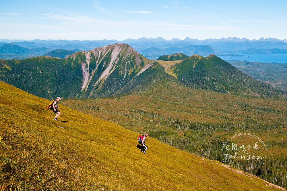 2 men running down Mt. Edgecumbe, Kruzof Island, Southeast Alaska