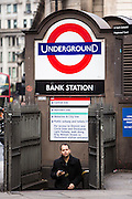 A British male walks up the steps of the subway to leave London Underground Bank Station, holding his mobile phone, United Kingdom.  Bank station opened in 1900 and is named after the Bank of England.  It is served by the Central, Northern and Waterloo and City lines.  Due to is central City of London location, the station complex is the ninth-busiest on the London Underground network.