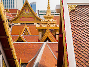 24 FEBRUARY 2013 - BANGKOK, THAILAND: The roofline of the buildings the are in the Wat Hua Lamphong complex. Wat Hua Lamphong is a Royal Buddhist temple, third class, in the Bang Rak District of Bangkok, Thailand. It is located on Rama IV Road, approximately 1 km from the city's main Hua Lamphong railway station. An entrance to Sam Yan Station on the Bangkok metro (subway) is located outside the main entrance to the temple compound on Rama IV. Wat Hua Lamphong was renovated in 1996 to mark the 50th anniversary of the ascension to the throne of King Bhumibol Adulyadej (Rama IX) in 1996. The royal seal of what became known as the Kanchanapisek, or Golden Jubilee, year, showing two elephants flanking a multi-tiered umbrella, are featured in the temple's remodeling.     PHOTO BY JACK KURTZ