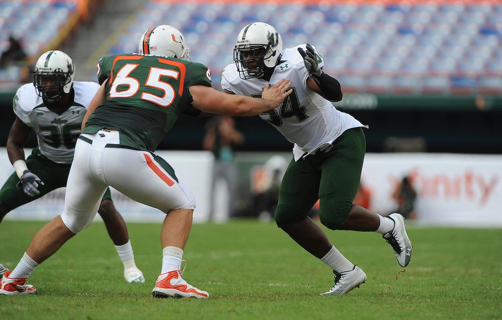 MIAMI GARDENS, FL - NOVEMBER 27: Julius Forte #54 in action during the game against the Miami Hurricanes at Sun Life Stadium in Miami Gardens, Florida on November 27, 2010. South Florida defeated the Hurricanes 23-20.