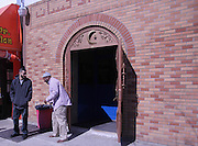March 14, 2014- Brooklyn, NY- Men outside the Masjid Al Ihsaan, the mosque on Fulton Street in Clinton Hill, Brooklyn, after Friday midday prayer.- 3/14/2014- Rosa Goldensohn/NY City Photo Wire