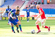 Charlton Athletic midfielder Jonathan Williams challenge the opponent during the EFL Sky Bet Championship match between Wigan Athletic and Charlton Athletic at the DW Stadium, Wigan, England on 21 September 2019.