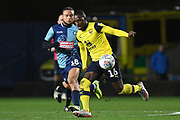 Oxford United midfielder Shandon Baptiste (16)battles for possession  with Wycombe Wanderers midfielder Curtis Thompson(18) during the EFL Sky Bet League 1 match between Oxford United and Wycombe Wanderers at the Kassam Stadium, Oxford, England on 21 December 2019.