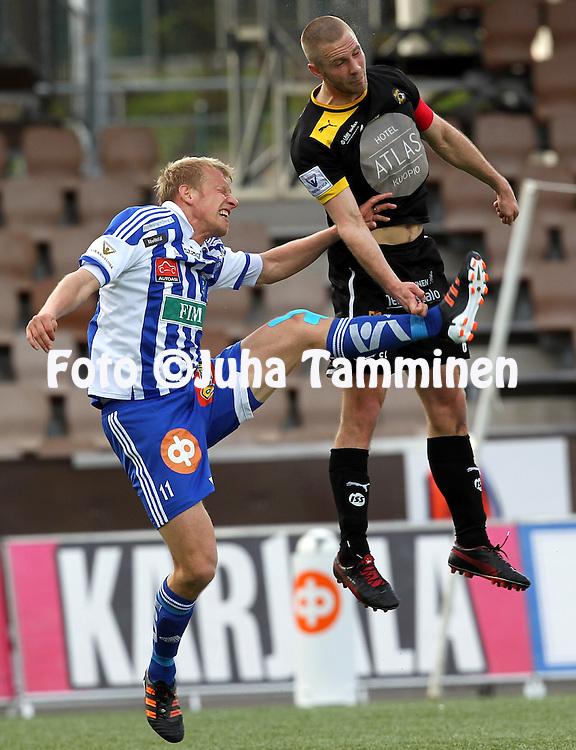 12.5.2012, Sonera Stadion, Helsinki..Veikkausliiga 2012..HJK Helsinki - Kuopion Palloseura..Pyry K?rkk?inen (KuPS) v Mathias Lindstr?m (HJK).