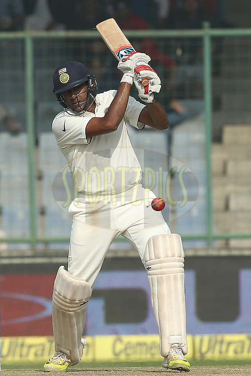 Ravichandran Ashwin of India drives down the ground during day two of the 4th Paytm Freedom Trophy Series Test Match between India and South Africa held at the Feroz Shah Kotla Stadium in Delhi, India on the 4th December 2015<br /> <br /> Photo by Ron Gaunt  / BCCI / SPORTZPICS
