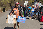 "Brooklyn, NY - 17 April 2016. A man who identified himself as Ricky Obama carries a Bernie sign alog with his poplitical manifesto. Vermont Senator Bernie Sanders, who is running as a Democrat in the U.S. Presidential primary elections, held a campaign ""get out the  vote"" rally in Brooklyn's Prospect Park."