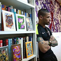Olympian and professional boxer Orlando Cruz of Puerto Rico pays his respects to the victims of the Pulse Nightclub shooting at The Center Orlando on Tuesday, July 12, 2016 in Orlando, Florida. Cruz, who lost four friends in the tragic incident was the first openly gay boxer in the sport and will fight for his fifth time in the Orlando area this Friday.  (Alex Menendez via AP)