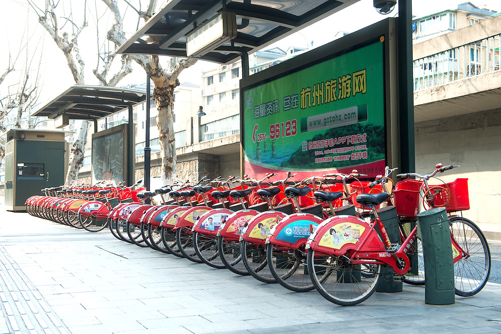 A row of bicycles on the street of Hangzhou for public to rent