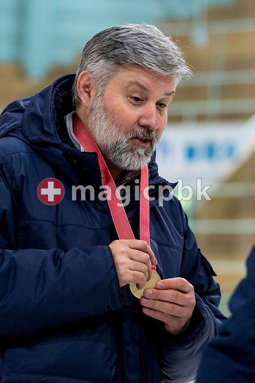 Rapperswil-Jona Lakers head coach Konstantin Kurashev holds the Swiss championships gold medal after winning the fifth Elite B Playoff Final ice hockey game between Rapperswil-Jona Lakers and ZSC Lions held at the SGKB Arena in Rapperswil, Switzerland, Sunday, Mar. 19, 2017. (Photo by Patrick B. Kraemer / MAGICPBK)