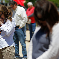 Thomas Wells | BUY at PHOTOS.DJOURNAL.COM<br /> Donna Russell joins others at Tupelo City Hall in Fairpark to take part in the National day of Prayer on Thursday.