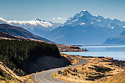 A scenic and windy road along the shores of Lake Pukaki leads to Mt Cook, New Zealand