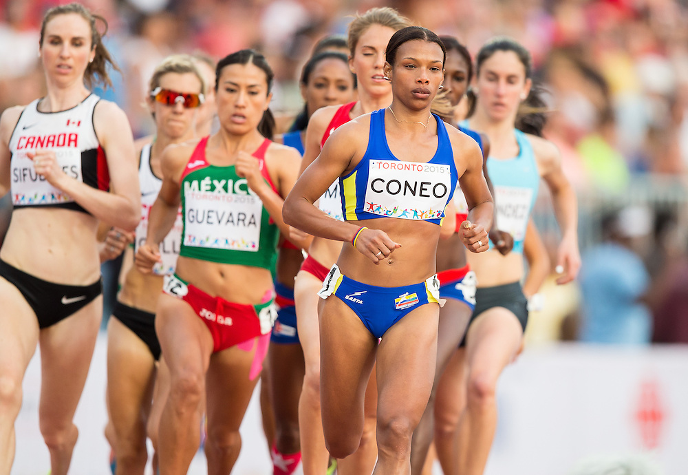 Muriel Coneo of Colombia leads the pack during the women's 1500 metres at the 2015 Pan American Games at CIBC Athletics Stadium in Toronto, Canada, July 25,  2015.  AFP PHOTO/GEOFF ROBINS