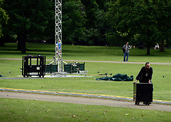 © Licensed to London News Pictures. 06/06/2012. London, UK. A man packs away stage equipment in St James Park today 06/06/12. Workmen begin the task of deconstructing the stages and scaffolding platforms put in place for the celebrations.  The Royal Jubilee celebrations. Great Britain is celebrating the 60th  anniversary of the countries Monarch HRH Queen Elizabeth II accession to the throne this weekend Photo credit : Stephen Simpson/LNP