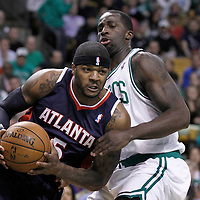 10 May 2012: Atlanta Hawks power forward Josh Smith (5) drives past Boston Celtics power forward Brandon Bass (30) during the Boston Celtics 83-80 victory over the Atlanta Hawks, in Game 6 of the Eastern Conference first-round playoff series, at the TD Banknorth Garden, Boston, Massachusetts, USA.