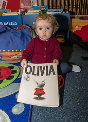 The most popular baby names in Scotland have been announced at Leith Library in Edinburgh. The most names for 2018 are unchanged from 2017 with Jack and Olivia taking the top spots.<br /> <br /> Pictured: 12 month old Lyra Rose Mackay holding a book titled with the most popular girl's name, Olivia