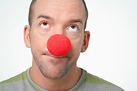 Man Wearing Clown Nose