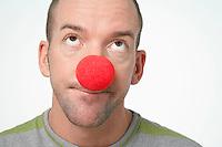 Man Wearing Clown Nose