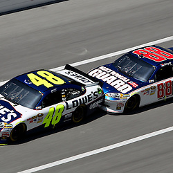 April 17, 2011; Talladega, AL, USA; NASCAR Sprint Cup Series driver Dale Earnhardt Jr. (88) bump drafts with Jimmie Johnson (48) during the Aarons 499 at Talladega Superspeedway.   Mandatory Credit: Derick E. Hingle