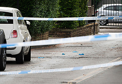 © Licensed to London News Pictures. 02/05/2019. London, UK. Medical gloves lie in the road behind a police cordon at Somerford Grove in Hackney where a 15 year old boy was stabbed to death last night. Scotland Yard say police were called just before 9.00pm.The boy was pronounced dead at the scene at 9.49pm. Photo credit: Peter Macdiarmid/LNP