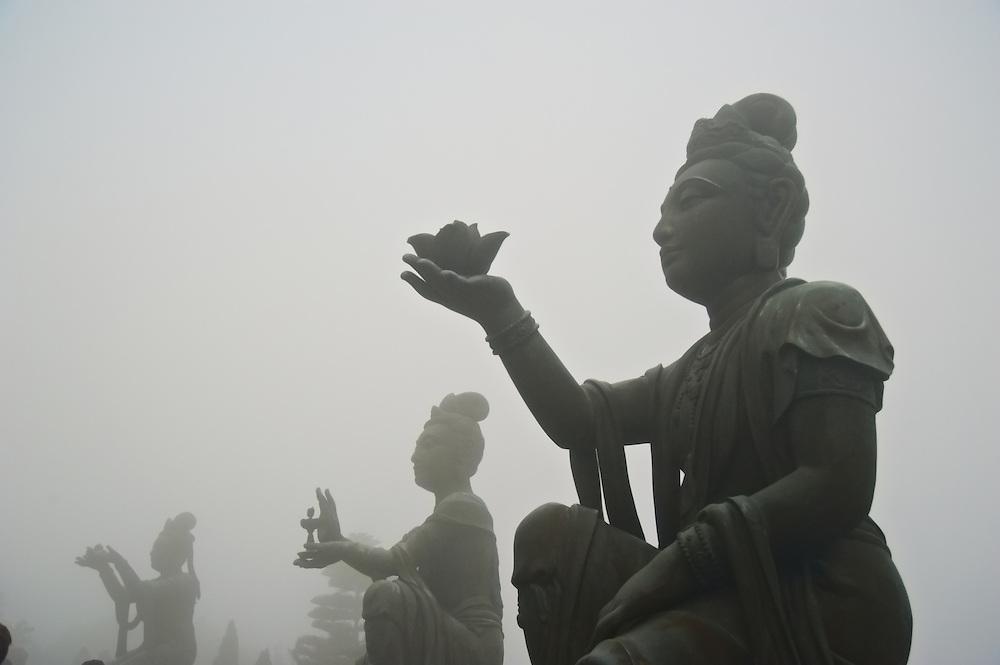Statues making offerings to the Big Buddha, Lantau, Hong Kong