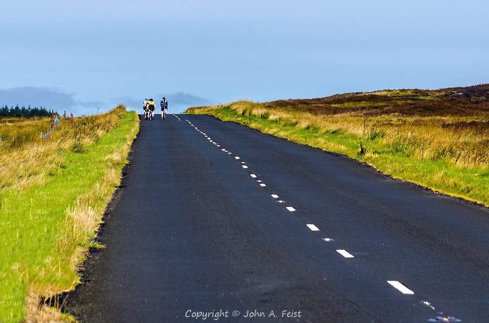 A local cycling club out for a ride on a beautiful day in County Antrim, Northern Ireland
