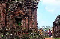 Tourists photographing the ancient Hindu temple complex of My Son Sanctuary, Vietnam