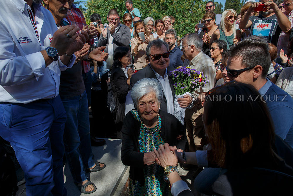 02/07/2017. Ascension Mendieta arrives with her son Francisco to the burial of her father, Timoteo Mendieta, who was assassinated in 1939 by dictator Franco's forces at a cemetery on July 2, 2017 in Madrid, Spain. General Franco forces killed Ascension's father Timoteo Mendieta in 1939 after Spain's Civil War and buried him in a mass grave in Guadalajara's cemetery together with another 22 people assassinated. Argentinian judge Maria Servini used the international human rights law and ordered the exhumation and investigation of Mendieta's mass grave. The exhumation was carried out by Association for the Recovery of Historical Memory (ARMH). Spain's Civil War took the lives of thousands of people on both sides, but Franco continued his executions after the war has finished. Spanish governments has never done anything to help the victims of the Civil War and Franco's dictatorship while there are still thousands of people missing in mass graves around the country. (© Pablo Blazquez)