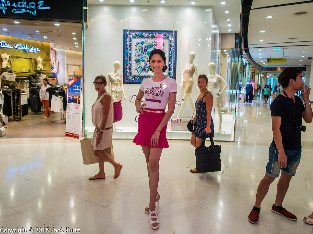 25 MARCH 2015 - BANGKOK, THAILAND: Contestants relax in the mall during the first round of the Miss Tiffany's contest at CentralWorld, a large shopping mall in Bangkok. Miss Tiffany's Universe is a beauty contest for transgender contestants; all of the contestants were born biologically male. The final round will be held on May 8 in the beach resort of Pattaya. The final round is televised of the  Miss Tiffany's Universe contest is broadcast live on Thai television with an average of 15 million viewers.     PHOTO BY JACK KURTZ