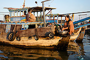 The floating market near Chau Doc, Vietnam.  People come to this market via boats to purchase produce which they sell at other markets in the region.