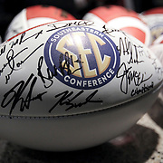 Each coach signs dozens of footballs when he arrives for SEC Media Days. ©Travis Bell Photography