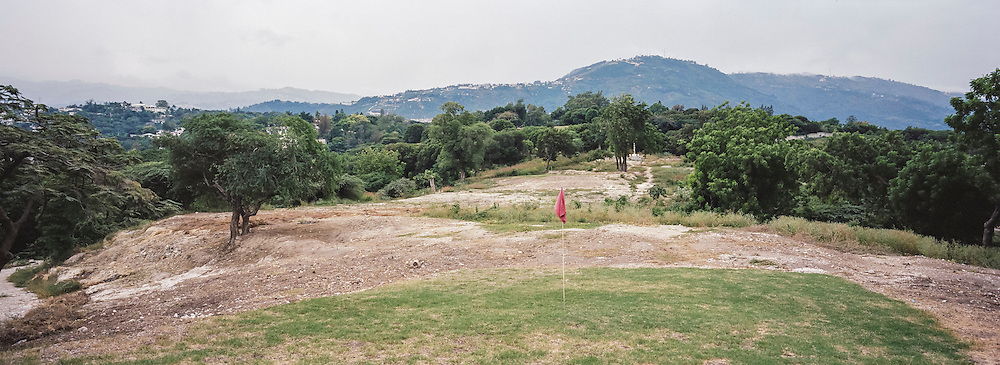 The Petionville Club golf course on Sunday, December 14, 2014 in Port-au-Prince, Haiti. Following the 2010 earthquake, the golf course turned into a tent city that housed tens of thousands of people, but they were just recently removed and the land reverted to private ownership.