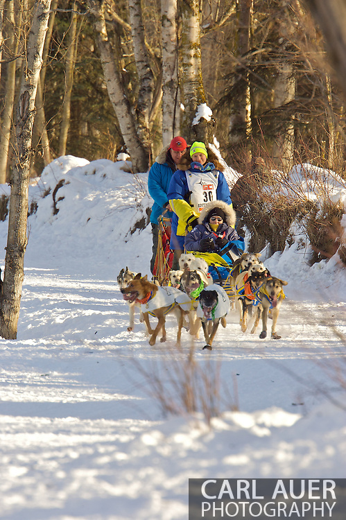 March 7th, 2009:  Anchorage, Alaska - Melissa Owens of Nome, Alaska brings her team through the woods during the start of the 2009 Iditarod.