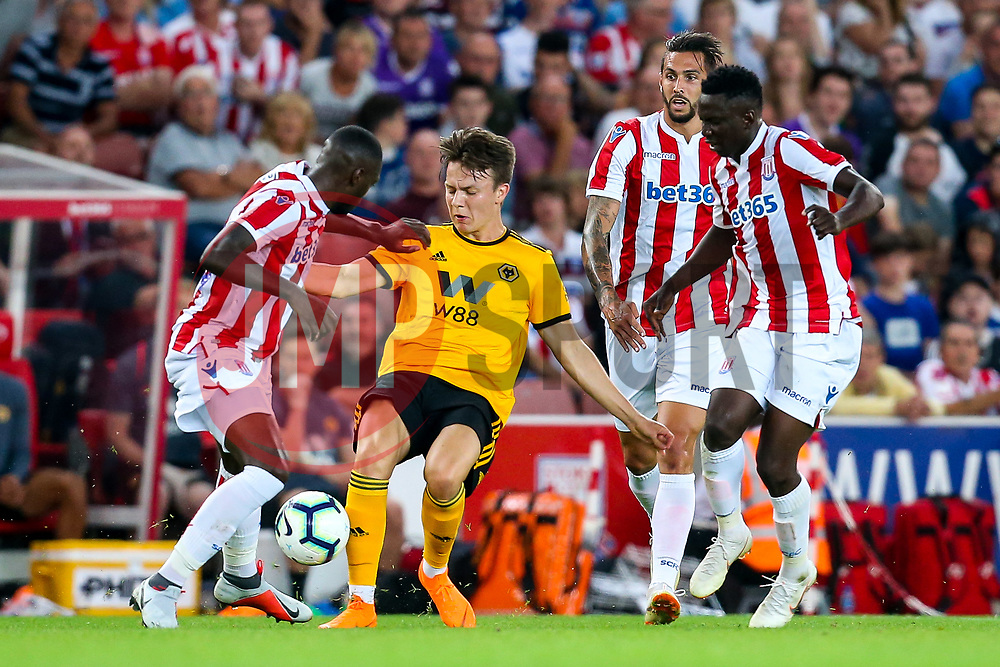 Oskar Buur of Wolverhampton Wanderers tackles Bruno Martins Indi of Stoke City - Mandatory by-line: Robbie Stephenson/JMP - 25/07/2018 - FOOTBALL - Bet365 Stadium - Stoke-on-Trent, England - Stoke City v Wolverhampton Wanderers - Pre-season friendly