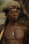Antandroy man wearing hat made from goat skin. These traditional hats are now rare to see. These 'people of thorns' live in the 'spiny' forests of Southern MADAGASCAR. <br />