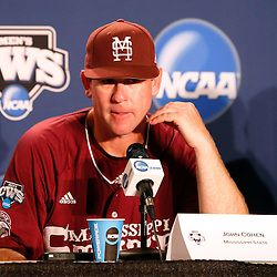 Jun 25, 2013; Omaha, NE, USA; Mississippi State Bulldogs head coach John Cohen (11) addresses the media in a press conference after game 2 of the College World Series finals against the UCLA Bruins at TD Ameritrade Park. UCLA defeated Mississippi State 8-0. Mandatory Credit: Derick E. Hingle-USA TODAY Sports