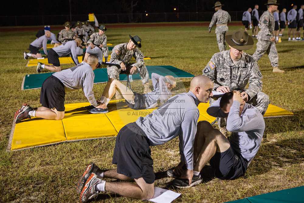 Drill Sergeant candidates at the US Army Drill Instructors School Fort Jackson take their entry physical training test early morning September 27, 2013 in Columbia, SC. While 14 percent of the Army is women soldiers there is a shortage of female Drill Sergeants.